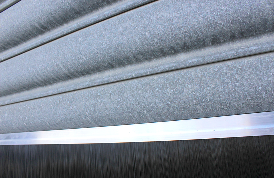 Doorstrip and Gutter Protector - Protecting your building from draughts, dust, leaves, birds and vermin